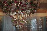 This is a hand made Christmas Ornament Chandelier that hangs from a relatively low ceiling so people can see the details of the ornaments.