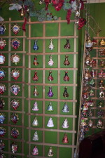 Notice how all the wall space is covered with inexpensive Christmas Ornament racks.