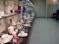 Krosno glass is displayed on long shelves in this showroom.
