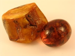 synthetic amber egg and natural baltic amber nugget